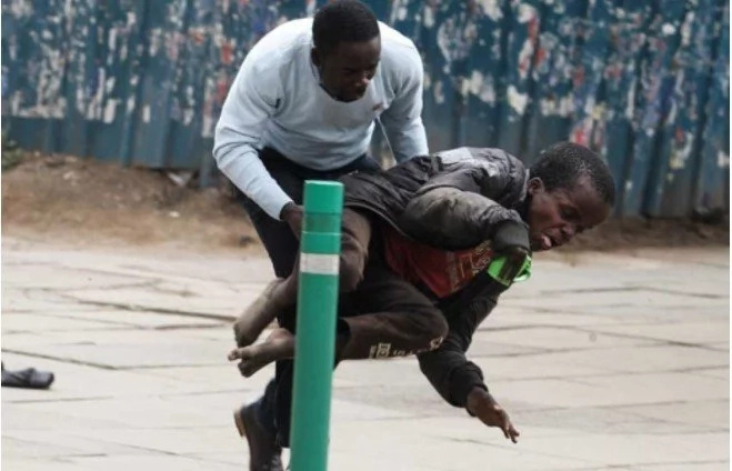 Photos: Journalist wins Kenyans' hearts by saving disabled man from swarm of bees