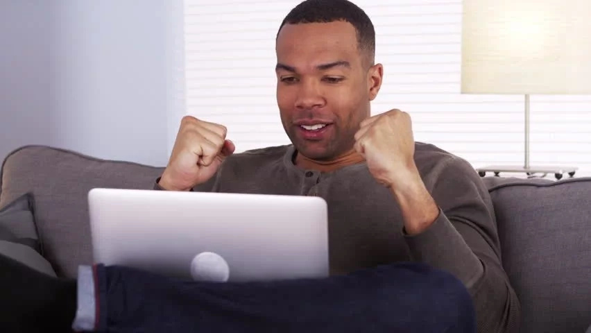 Happy man with a laptop