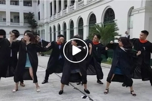 College dancers keep it cool on their graduation day and march with a swag dance routine