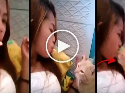 Watch this careless Pinay use her mouth to feed her pet cat. What happens next will make you afraid of cats forever!