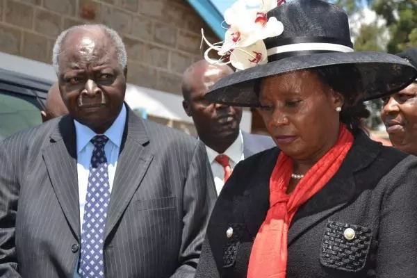 Kibaki's female companion at Nderitu Gachagua's raises eyebrows