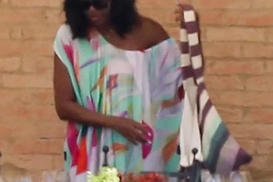 Sexy Tuscan look! Michelle Obama has opted for off-the-shoulder outfits during her blissful Italy trip (photos)