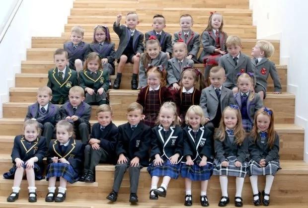 The 13 sets of twins. Photo: Jane Barlow/PA Wire