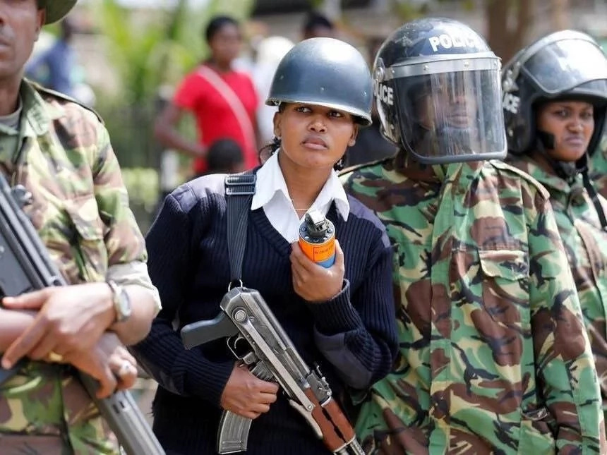Female anti-riot officer stuns protesters with her killer looks as collegue carries a panga