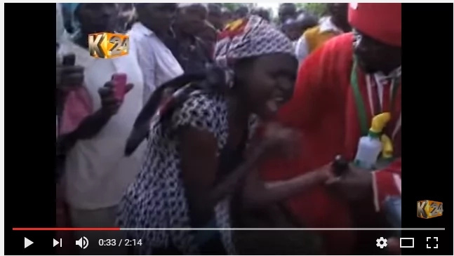 A shocking video of a prophet removing demons from two sisters