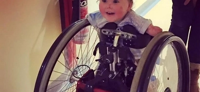 Miracle toddler take first steps on walking frame after losing legs and arms to meningitis