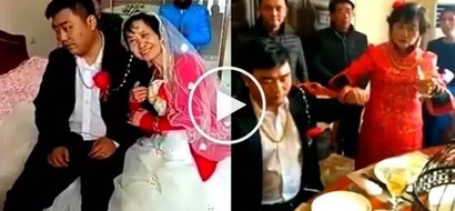 Napilitan lang! Asian groom acts miserably during wedding ceremony with his elderly bride