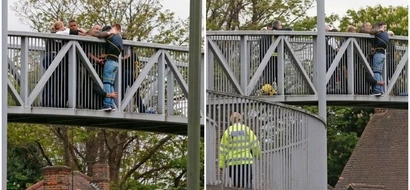 Human compassion! Good Samaritans hold on to man for 2 HOURS to stop him from jumping off bridge (photos)