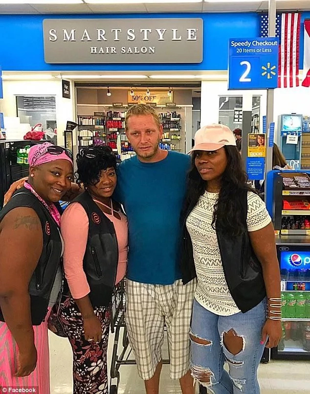 The sisters pictured with the man they helped. Photo: Facebook