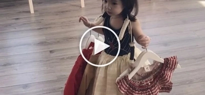 Baby Olivia's love for clothes is revealed when she adorably shops 'til she drops