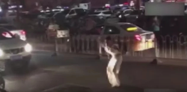 Woman dances around body of pedestrian she ran over