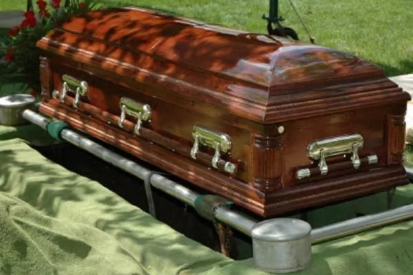 Government official buried with money