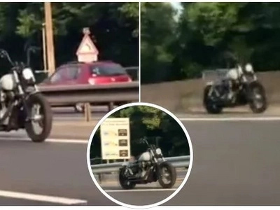 Driving along the high way doesn't always have to be boring. Bike without a rider leaves everyone in disbelief (video)