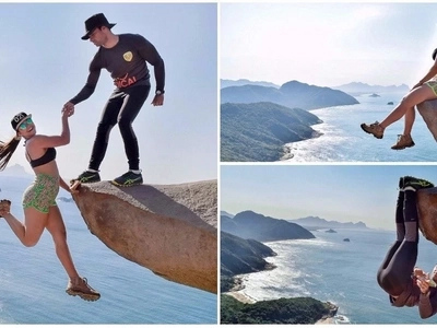 Woman seems to hang off 335-meter cliff by fiancé's hand - but is it as it seems?