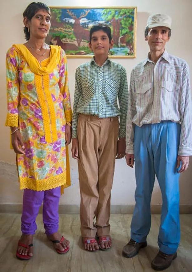 Karan with his mom and dad. Photo: Barcroft