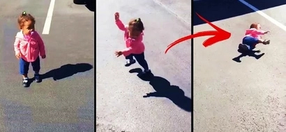 Little girl was caught on video getting scared of her own shadow. She tried to escape but she suffered an epic fail instead!
