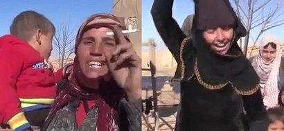 Jubilation! Women set face veils on FIRE after their village liberated from ISIS terrorists (see photos, video)