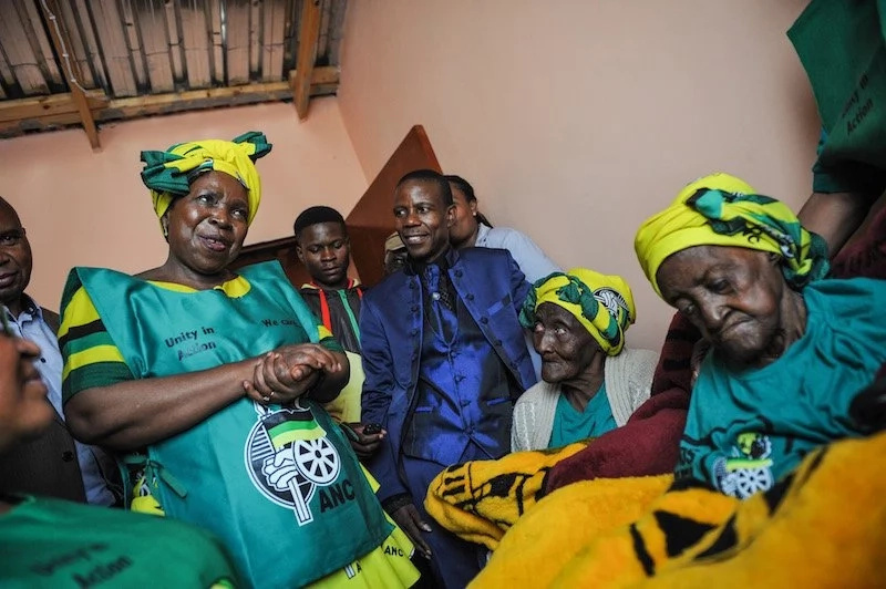 Former AU Commission Chairperson Nkosazana Dlamini-Zuma (front, standing) visiting Ramatse (seated, right)