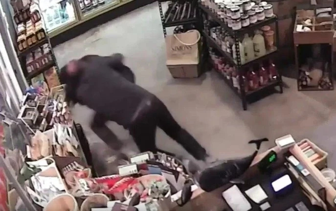 Heroic Store Owner Wrestles An Armed Robber In Incredible Footage
