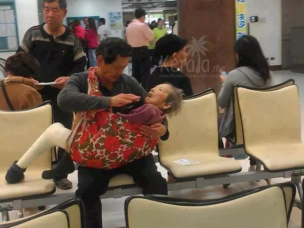 Touching photo of man feeding his senile mother