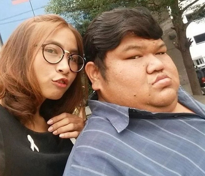 """He's fat and UGLY but I love him,"" slim girl shows off her 120kg boyfriend (photos)"
