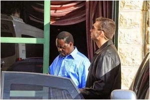 Why Raila is protected by these foreign bodyguards? (photos)