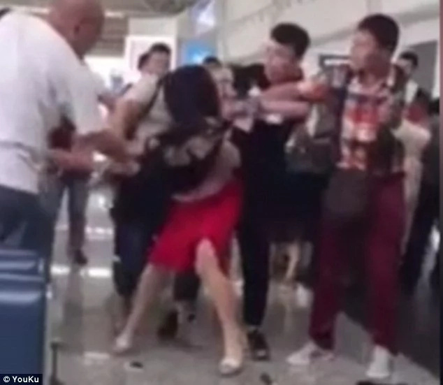 Chinese wife beats and strips her husband's mistress