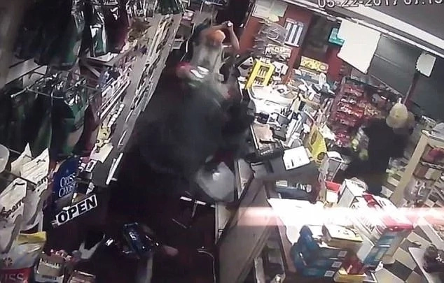 Brave! Store owner and his wife clobber and chase away 2 armed robbers with STICKS (photos)