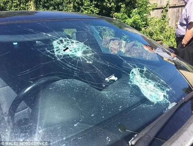 This is what you get when you cheat your girl. Woman smashed boyfriend's BMW windscreen and windows