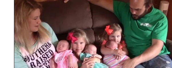 Mom gave birth to three healthy kids. Then doctor noticed strangeness, looking at their faces