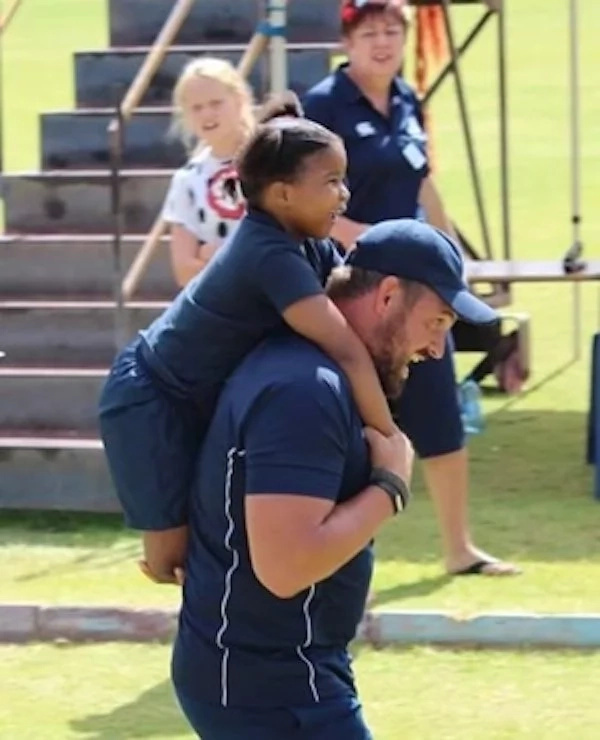 Teacher stole hearts as he gave DISABLED girl piggyback ride in 60 metre race (see photos)
