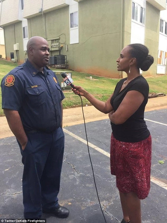 The firefighter Robert Sutton speaking to a local reporter after his fast-acting rescue effort