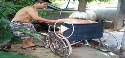 Emotional netizens applaud Pinoy caught on camera affectionately giving his old mother a bath