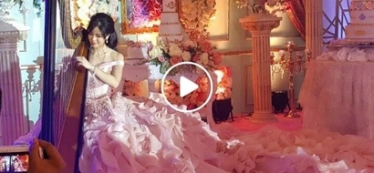 Classic beauty and talent! Kisses Delavin serenades guests on her 18 birtday as she performs with her harp