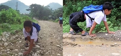 Inspiring boy crawls backwards going to school despite knee deformity