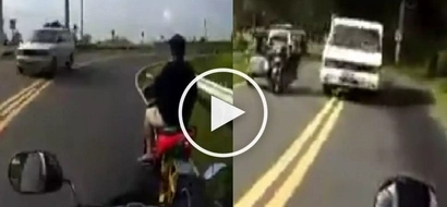 See Pinoy motorcycle rider's unbelievable escape from death!