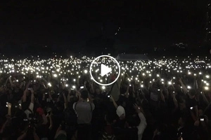 Parang yung sa Hogwarts! Anti-Marcos activists raise their lit mobile phones as a sign of protest in