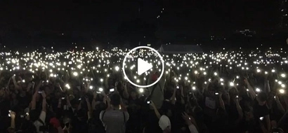 "Parang yung sa Hogwarts! Anti-Marcos activists raise their lit mobile phones as a sign of protest in ""Black Friday"" rally"