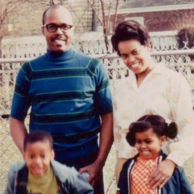 Michelle and her brother Craig with their parents