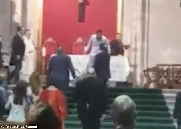 Confusion as man, 22, storms CHURCH wedding shouting 'Allah is great' and attacks priest (photos)