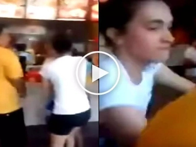 Emotional Filipina wife savagely assaults husband's lover while ordering fast food at Jolibee
