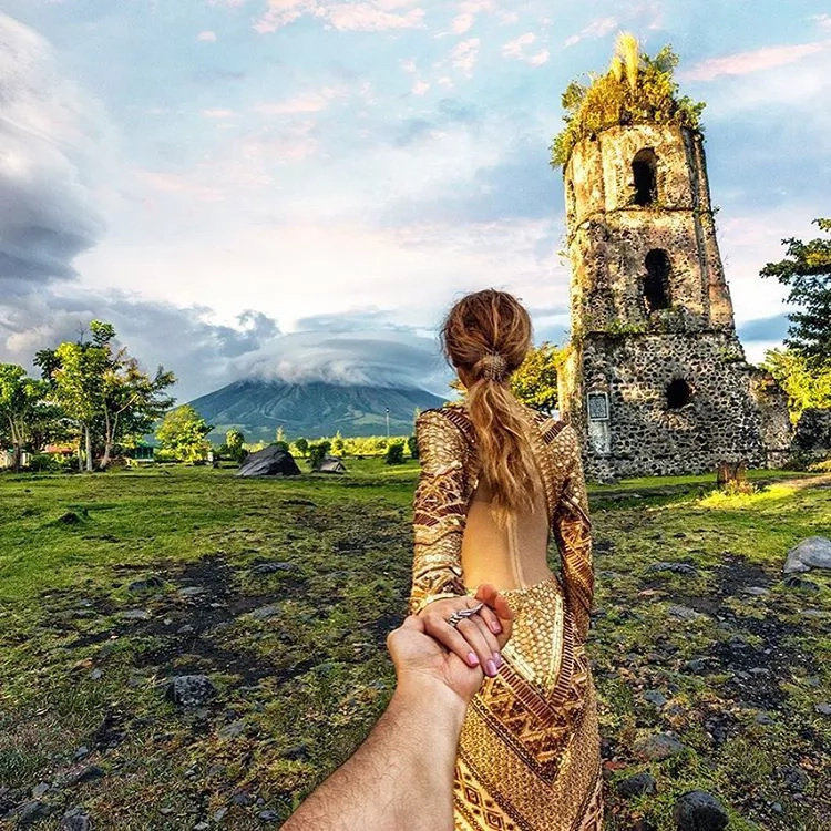 Famous #FollowMeTo couple climb Mount Mayon