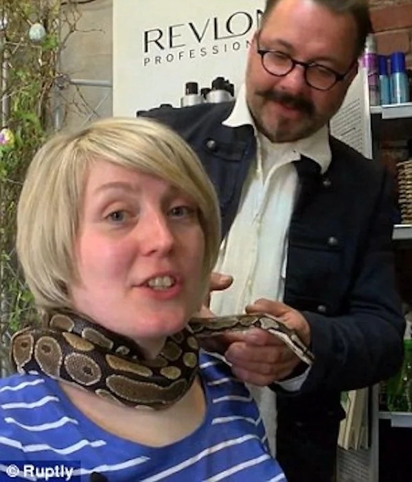 Slithery relaxation! This hair salon offers neck massage by a PYTHON and it's proving popular (photos, video)