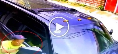 Elderly Pinoy thief caught on CCTV stealing side mirrors from parked SUV in Quezon City