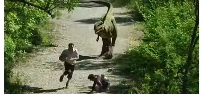Man Surprised to See A Dinosaur Came Out From A Bushy Area