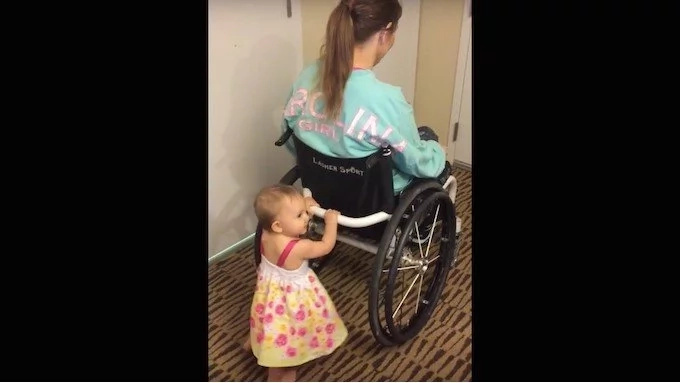 Paralyzed mom uses Her wheelchair to teach her baby how to walk