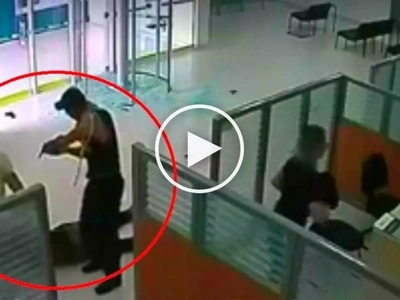 Vigilant security guard's epic fight with 2 deadly hold-uppers in bank caught on CCTV