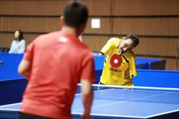 Ibrahim goes head to head with some of the world's best. Photo: FB.com/ITTFWorld & Remy Gros