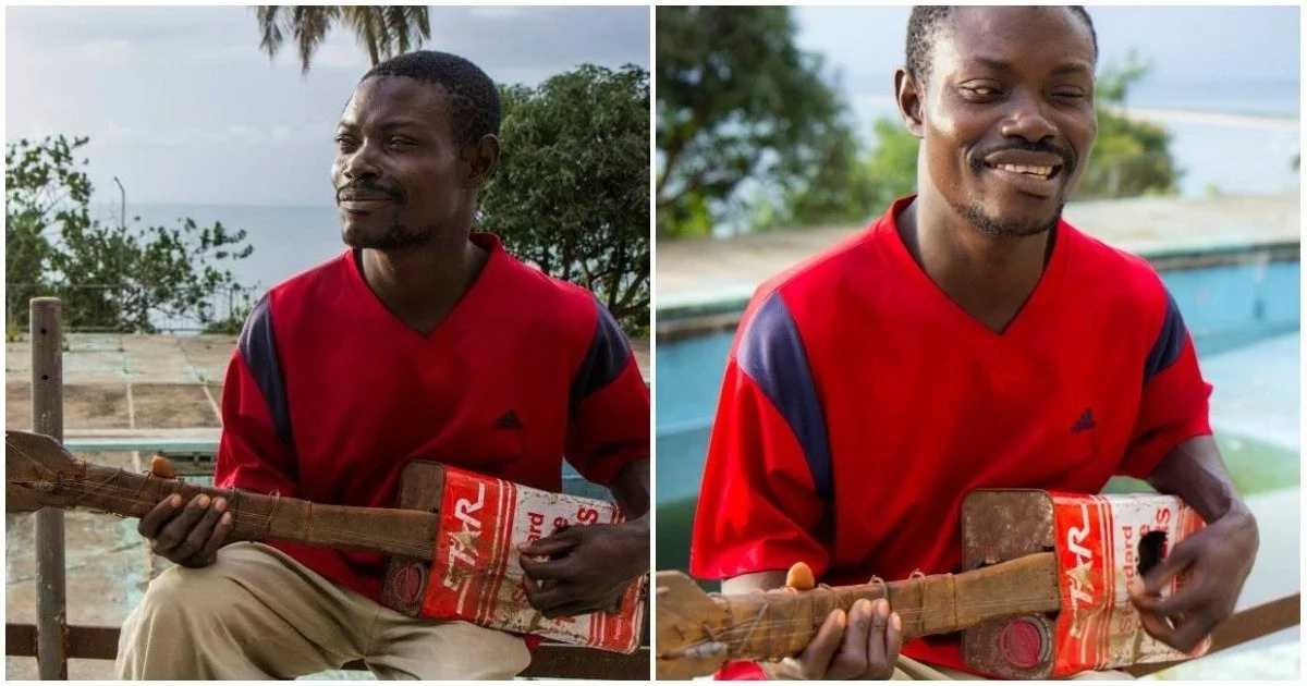 Pure talent! Blind Liberian man creates guitar out of oil cans and plays it well too