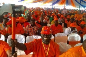 ODM youths beats up a Jubilee politician in front of police